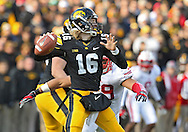 November 02 2013: Iowa Hawkeyes quarterback C.J. Beathard (16) sets to throw during the second half of the NCAA football game between the Wisconsin Badgers and the Iowa Hawkeyes at Kinnick Stadium in Iowa City, Iowa on November 2, 2013. Wisconsin defeated Iowa 28-9.