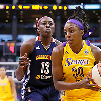 03 August 2014: Los Angeles Sparks forward Nneka Ogwumike (30) drives past Connecticut Sun forward Chiney Ogwumike (13) during the Los Angeles Sparks 70-69 victory over the Connecticut Sun, at the Staples Center, Los Angeles, California, USA.