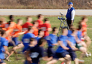 Warwick, N.Y. - Runners sprint past the starter take at the start of a boys race at the New York State Public High School Athletic Association cross country championships at Sanfordville Elementary School on Nov. 11, 2006. The runners are blurred because of slow shutter speed.<br />