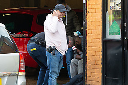 Police attend the scene of a stabbing where a bearded man appears to be suffering a facial injury on Bromley Road at the corner of Lee Bridge Road in Leyton, NE London.. London, January 09 2019.
