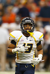 Oct 21, 2011; Syracuse NY, USA;  West Virginia Mountaineers running back Andrew Buie (13) lines up for a play against the Syracuse Orange during the fourth quarter at the Carrier Dome.  Syracuse defeated West Virginia 49-23. Mandatory Credit: Jason O. Watson-US PRESSWIRE