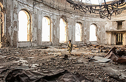 French ISAF or International Security and Assistance Force soldiers and an Afghan soldier explore the ruins of the former Presidential palace in in Kabul, Afghanistan  August  11, 2002.    (photo by Ami Vitale)
