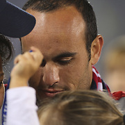 An emotional Landon Donovan, USA, shares a moment with family and friends after his farewell match during the USA Vs Ecuador International match at Rentschler Field, Hartford, Connecticut. USA. 10th October 2014. Photo Tim Clayton