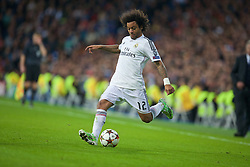 MADRID, SPAIN - Tuesday, November 4, 2014: Real Madrid's Marcelo in action against Liverpool during the UEFA Champions League Group B match at the Estadio Santiago Bernabeu. (Pic by David Rawcliffe/Propaganda)