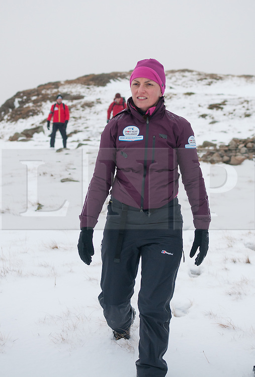 © Licensed to London News Pictures. 09/02/2014. Scafell, UK Davina McCall climbing Scafell Pike today, as part of her Sport Relief challenge. Photo credit : Stewart Smith/LNP