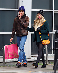 Singer Pixie Lott and her model boyfriend Oliver Cheshire out shopping in London. Pixie wearing long hair extensions a black Moschino woolly hat, green jacket with fur collar, white blouse, leather gloves, short black skirt, ankle boots and a orange hand bag that matched Oliver's socks. The young couple seemed very much in love as they walked hand in hand around the shops, where Pixie tried on a jacket and bought a paisley skirt. After shopping the pair grabbed a bite to eat at Pilpel's falafel & houmous bar before heading home... UK. 25/10/2012<br />