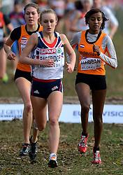 08-12-2013 ATHLETICS: SPAR EC CROSS COUNTRY: BELGRADE<br /> Sifan Hassan heeft vandaag haar favorietenrol waargemaakt. De atlete, die pas enkele weken geleden haar Nederlandse paspoort kreeg, won vandaag het EK Cross onder 23 jaar. Links Maureen Koster en PARTRIDGE, Lily GBR<br /> ©2013-WWW.FOTOHOOGENDOORN.NL