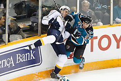 January 8, 2011; San Jose, CA, USA; San Jose Sharks right wing Ryane Clowe (29) check Nashville Predators defenseman Cody Franson (left) against the boards during the first period at HP Pavilion. Mandatory Credit: Jason O. Watson / US PRESSWIRE