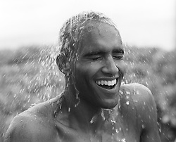 man enjoying the feel of water over his head from a shower