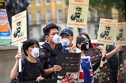 © Licensed to London News Pictures. 01/08/2019. LONDON, UK.  Members of the Hong Kong Chinese community in London stage a protest outside the Cabinet Office in Whitehall calling for Boris Johnson, Prime Minister, to intervene and to help Hong Kong.  The former British colony is in its eighth consecutive weeks of protests, which were sparked by a proposed extradition bill that would allow suspects to be sent to mainland China.  Photo credit: Stephen Chung/LNP