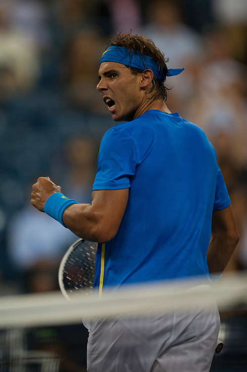 NEW YORK, NY - SEPTEMBER 12: Rafael Nadal of Spain reacts after a point in a match against Novak Djokovic of Serbia  during the Men's Final on Day Fifteen of the 2011 US Open at the USTA Billie Jean King National Tennis Center on September 12, 2011 in the Flushing neighborhood of the Queens borough of New York City. (Photo by Rob Tringali) *** Local Caption *** Rafael Nadal