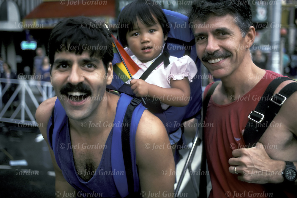 Gay Fathers with adopted Asian daughter at Heritage of Pride Parade