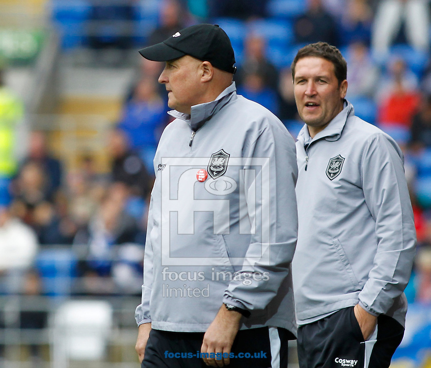 Russell Slade (L), Manager of Cardiff City during the Sky Bet Championship match at the Cardiff City Stadium, Cardiff<br /> Picture by Mike  Griffiths/Focus Images Ltd +44 7766 223933<br /> 18/10/2014