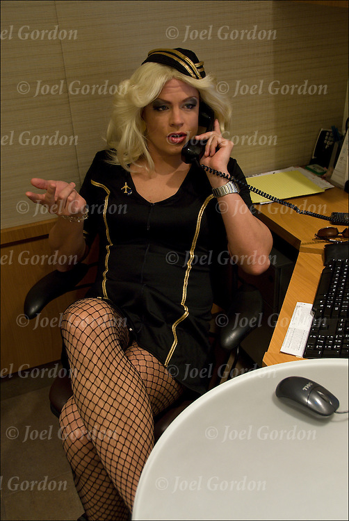Adults to old for trick-or-treat will attend costume party at work instead. Portrait of Hot Blondie Drag Flight Attendant.