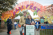 Dave and Michelle Kelsey with their festive signage and the entrance to the first annual Abita Fall Fest in Abita Springs Park on November 2, 2019; photo ©2019, George H. Long