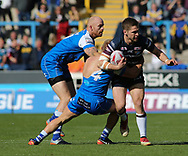 Brandon Moore (C) of Halifax RLFC tackles Matt Parcell (R) of Leeds Rhinos during the Super 8s The Qualifiers match at Mbi Shay Stadium, Halifax<br /> Picture by Stephen Gaunt/Focus Images Ltd +447904 833202<br /> 23/09/2018