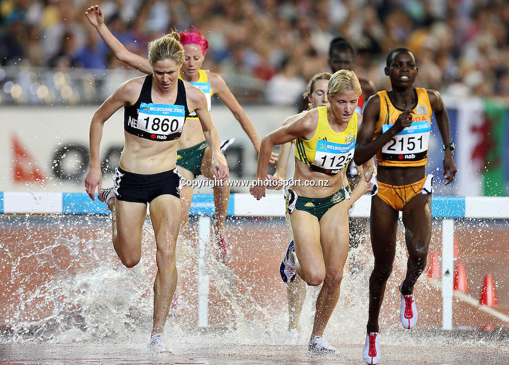 (L) Kate McIlroy (NZL) races in the Women's 3000m Steeplechase on Day 7 of the XVIII Commonwealth Games at the MCG, Melbourne, Australia on Wednesday 22 March, 2006. Photo: Hannah Johnston/PHOTOSPORT
