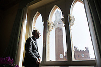 SIENA, ITALY - 20 MARCH 2015:  Marcello Clarich (57), President of the Monte dei Paschi di Siena Foundation, poses for a portrait at Palazzo Sansedoni (headquarters of the foundation) in Siena, Italy, on March 20th 2015. <br /> <br /> The charitable Monte dei Paschi di Siena Foundation is the bank's largest shareholder that has financed projects in the fields of economic development, art and research. Until 2014, the Foundation has entirely funded Siena Biotech, a clinical-stage drug discovery company whose  efforts are mainly focused on discovering new drugs for therapeutic intervention against neurodegenerative diseases and in oncology, such as Alzheimer&rsquo;s Disease, Huntington&rsquo;s Disease and Cancer.<br /> <br /> Now Siena Biotech has filed for bankruptcy proceedings, and its researchers and employees occupied the headquarters of the company based in Siena.<br /> <br /> Siena, a Tuscan city and UNESCO World Heritage Site, is home to Monte dei Paschi di Siena, the world's oldest surviving bank and Italy's third largest bank. The bank, founded in 1472, was the largest employer in Siena, and it helped finance a host of community projects and services until it stumbled during the financial crisis started in 2008.
