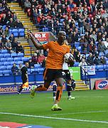 Benik Afobe peels away in celeration after his spot kcik goalduring the Sky Bet Championship match between Bolton Wanderers and Wolverhampton Wanderers at the Macron Stadium, Bolton, England on 12 September 2015. Photo by Mark Pollitt.
