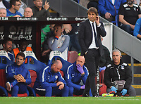 Football - 2017 / 2018 Premier League - Crystal Palace vs. Chelsea<br /> <br /> Chelsea Manager, Antonio Conte scratches his head as his team slip to defeat at Selhurst Park.<br /> <br /> COLORSPORT/ANDREW COWIE
