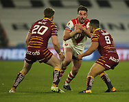 Adam Walne (L) and Kruise Leeming (R) of Huddersfield Giants tackle Luke Douglas (C) of St Helens during the Betfred Super League match at the John Smiths Stadium, Huddersfield<br /> Picture by Stephen Gaunt/Focus Images Ltd +447904 833202<br /> 23/02/2018