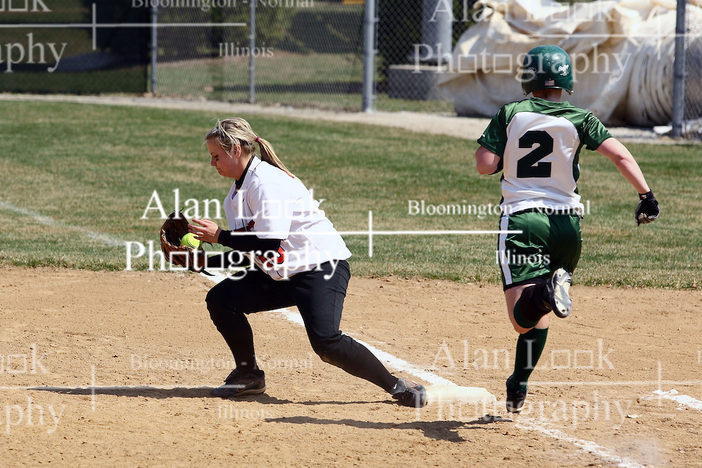 05 April 2008: First base player Jacquelyn Tassone scoops up a throw that puts out batter Natalie Chase. The Carthage College Lady Reds lost the first game of this double header to the Titans of Illinois Wesleyan 4-1 at Illinois Wesleyan in Bloomington, IL