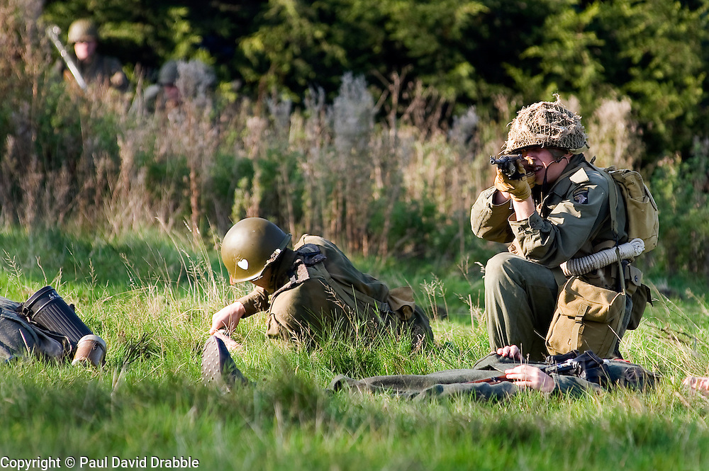 Reenactors portraying US Airborne troops sneak up on German sentries during a small scale Skirmish at the Northallerton Wartime weekend charity fundraiser for Help for Heros and Ben Hyde Memorial Trust 9th &amp;10th Ocober 2010 .Images <br />