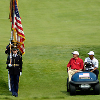 04 July 2007:  Former President George H. W. Bush and Tiger Woods review the color guard as they arrive at the first tee to start the inaugural AT&T National PGA event at Congressional Country Club in Bethesda, Md. The proceeds of the golf tournament will benefit the Tiger Woods Foundation and local Washington, DC, based charities.  ****For Editorial Use Only