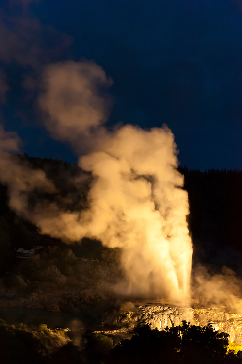 The 30 meter high Pohutu Geyser erupting, Illuminated for a night view at the Te Puia (New Zealand Maori Arts & Crafts Institute), Whakarewarewa Thermal Valley, Rotorua, North Island, New Zealand.