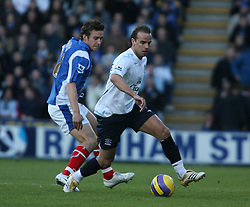 PORTSMOUTH, ENGLAND - SATURDAY, DECEMBER 9th, 2006: Andy Van Der Meyde of  Everton clashes with Sean Davis of Portsmouth during the Premiership match at Fratton Park. (Pic by Chris Ratcliffe/Propaganda)