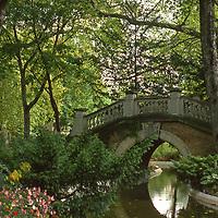 Peaceful bridge in the elegant Parc Monceau a leafy part of Paris