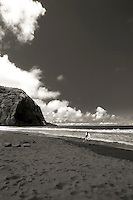 Young surfer heads out at Waipio Valley, HI.  Copyright 2008 Reid McNally.