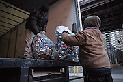"25 November 2013 - New York, NY [Austin ""Guy"" Butler delivers 13 bags of recycling to a truck on 60th Street in Manhattan.  He makes about $130 for delivering over 2,000 bottles and cans.] 11/25/13 Stoneham/CUNY Journalism Photo"