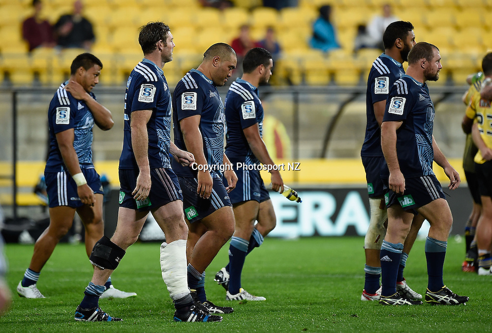 The dejected Blues walk over to shake hands with the Hurricanes after the Blues loss during the Super Rugby - Hurricanes v Blues match at the Westpac Stadium in Wellington on Friday the 18th of April 2014.  Photo by Marty Melville/Photosport.co.nz