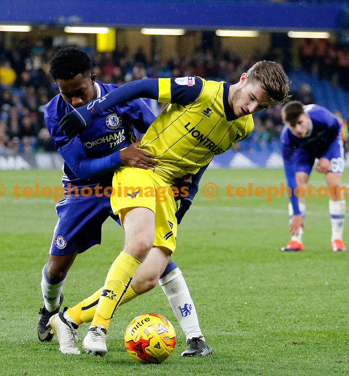 Chelsea's Josimar Quintero has Oxford's Daniel Crowley in close attention during the Checkatrade Trophy match between Chelsea U21's and Oxford United at Stamford Bridge in London. November 8, 2016.<br /> Carlton Myrie / Telephoto Images<br /> +44 7967 642437