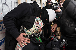 Licensed to London News Pictures. Calais, France. 03/03/16. An Iranian man has his lips sewn together as he begins a hunger strike to protest the eviction of the Calais 'Jungle'. French authorities are clearing the southern half of the Calais 'Jungle' camp, which charities estimate to contain 3,500 people.. Photo credit : Rob Pinney/LNP