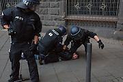 Frankfurt | Germany | 10.09.2015: Bei einer von der TGB (Bund t&uuml;rkischer Jugendlicher) angemeldeten Demonstration mit ca. 500 Teilnehmern kommt es zu Auseinandersetzung mit kurdischen Gegendemonstranten, die u.a. mehrere Stunden die Demoroute an der Paulskirche blockieren.<br /> <br /> hier: Immer wieder versuchen kleiner Gruppen t&uuml;rkischer Nationalisten zu den Kurden durchzubrechen und suchen die Konfrontation. Polizisten nehmen einen der Provokatuere fest.<br /> <br /> 20150910<br /> Sascha Rheker<br /> <br /> [Inhaltsveraendernde Manipulation des Fotos nur nach ausdruecklicher Genehmigung des Fotografen. Vereinbarungen ueber Abtretung von Persoenlichkeitsrechten/Model Release der abgebildeten Person/Personen liegt/liegen nicht vor.] [No Model Release | No Property Release]