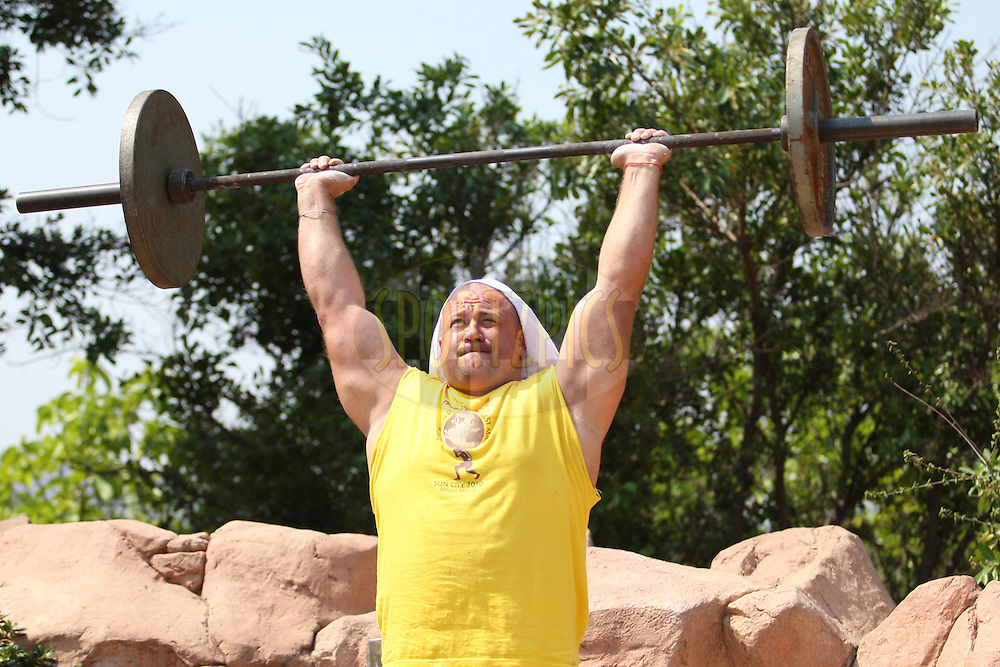 Kostiantyn Ilin (Ukraine) warms up before the dumbell overhead lift, one of the qualifying rounds of the World's Strongest Man competition held in Sun City, South Africa.