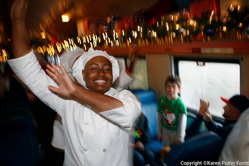 Chef sing up and down the aisles of a  special Polar Express train in Batesville, Mississippi on Sunday, while passing out cookies and hot Cocoa. Pajama-clad children and their parents took the special train on an hour long trip, departing from Batesville. Passengers listened to a recording of the Polar Express book, read by the author. About 3,000 rode the train over the weekend. The train is run by the Iowa Pacific, which recently took over the ex-Illinois Central line between Memphis and Jackson. The train runs various times through December 27th. This is the first time the train has come to Mississippi.