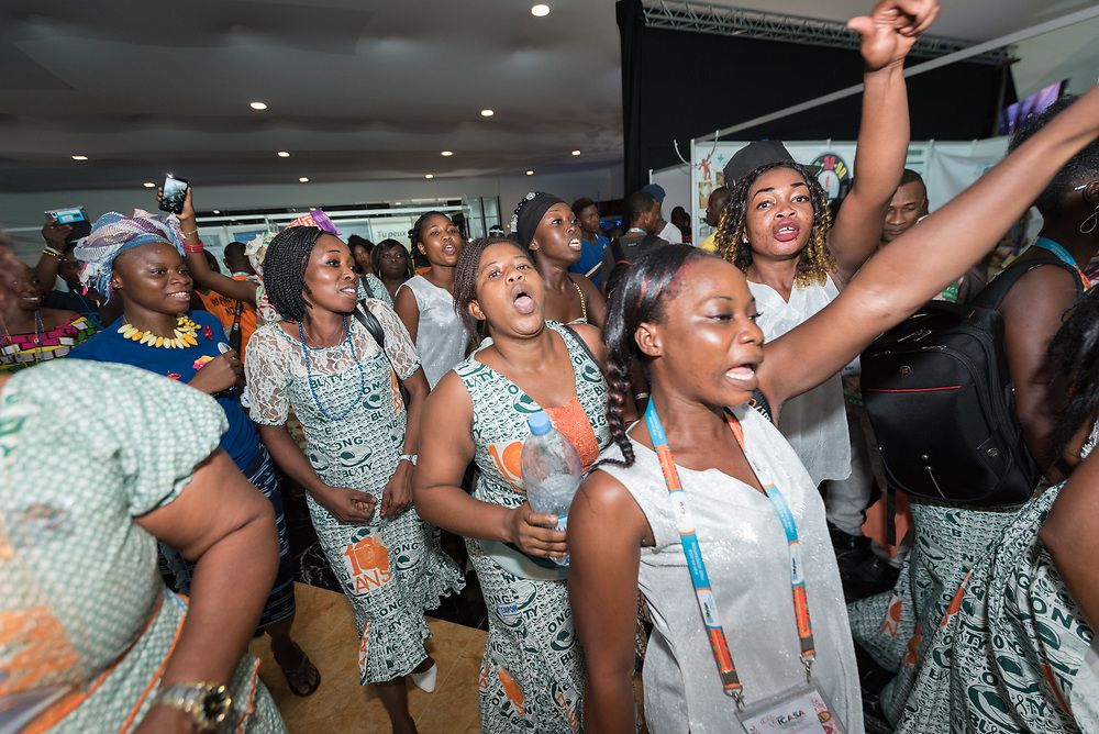 6 December 2017, Abidjan, Côte d'Ivoire: A group of women protest in support of sex workers' rights, in the Global Village area of ICASA 2017. The 19th International Conference on AIDS and STIs in Africa (ICASA) 2017 gathers thousands of researchers, medical professionals, academics, activists and faith-based organizations from all over the world, all looking to overcome the HIV epidemic and eliminate AIDS as a public health threat.