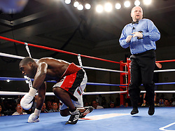 July 27, 2007; Saratoga Springs, NY, USA; Andre Berto (White/Red Trunks) gets knocked down by Cosme Rivera (White/Blue Trunks) during their 10 round bout at the Saratoga Springs City Center.  Berto won via 10 round unanimous decision.