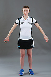 Umpire Louise Travis signalling obstruction of player without ball