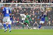 Fulham striker, Moussa Dembele (25) with shot on goal during the Sky Bet Championship match between Fulham and Cardiff City at Craven Cottage, London, England on 9 April 2016. Photo by Matthew Redman.