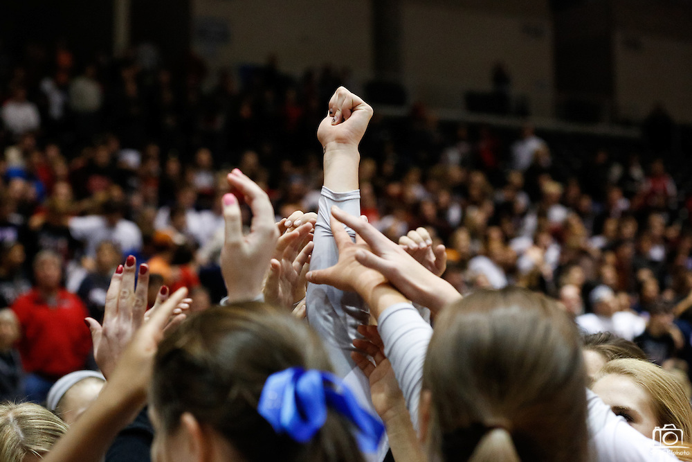 Coppell celebrates their Class 5A semi-finals win over Houston Clear Lake at the Curtis Culwell Center in Garland, Texas, on November 16, 2012.  (Stan Olszewski/The Dallas Morning News)