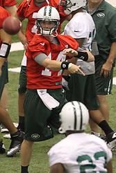 June 12, 2012; Florham Park, NJ, USA; New York Jets quarterback Greg McElroy (14) throws a pass to New York Jets running back Shonn Greene (23) during New York Jets Minicamp at the Atlantic Health Training Center.