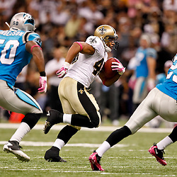 October 3, 2010; New Orleans, LA, USA; New Orleans Saints running back Ladell Betts (46) runs as Carolina Panthers linebacker James Anderson (50) and safety Jordan Pugh (29) pursue during the second half at the Louisiana Superdome. The Saints defeated the Panthers 16-14. Mandatory Credit: Derick E. Hingle