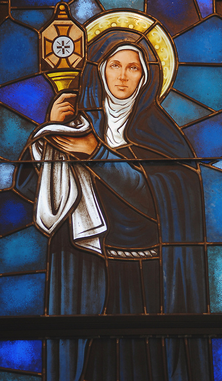 An image of St. Clare of Assisi is depicted in a stained glass window at the Basilica of St. Josaphat in Milwaukee. (Photo by Sam Lucero)