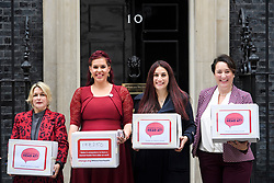 © Licensed to London News Pictures. 08/10/2018. Labour MP LUCIANA BERGER (2R) is joined by campaigner NATASHA DEVON (2L) and other campaigners as they hand the Mental Health First Aid England petition titled 'Where's Your Head At?', at the front door of 10 Downing Street, calling for a law change. Photo credit: Ben Cawthra/LNP