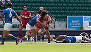 Twickenham. UK. 2015. Canada's Nathan HIRAYAMA, is gatherin by the the Samoan defence, during the Canada vs Samoa.Marriott London Sevens. RFU Twickenham Stadium. Surrey. 16.05.2015. [Mandatory Credit: Peter Spurrier/Intersport Images]