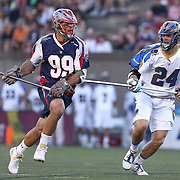 Paul Rabil #99 of the Boston Cannons tries to get past Ryan Flanagan #24 of the Charlotte Hounds during the game at Harvard Stadium on May 17, 2014 in Boston, Massachuttes. (Photo by Elan Kawesch)